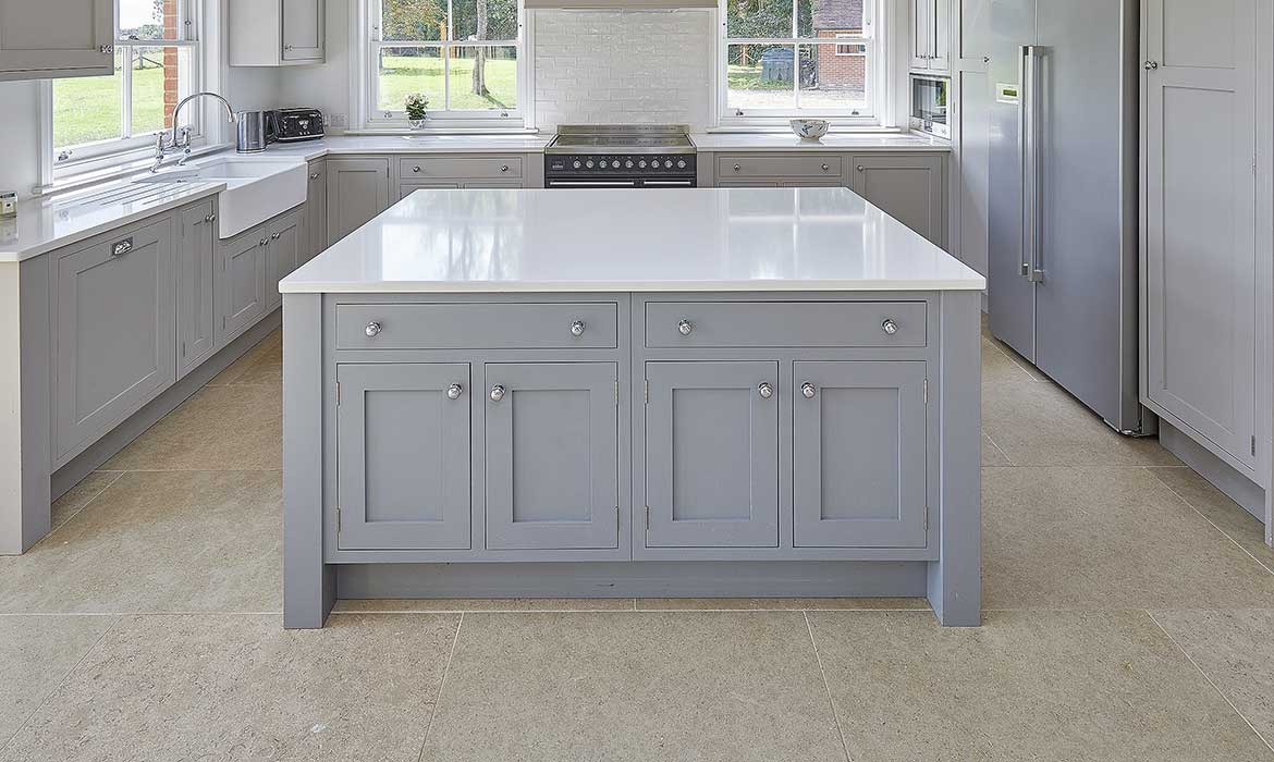 Large light grey shaker style kitchen island