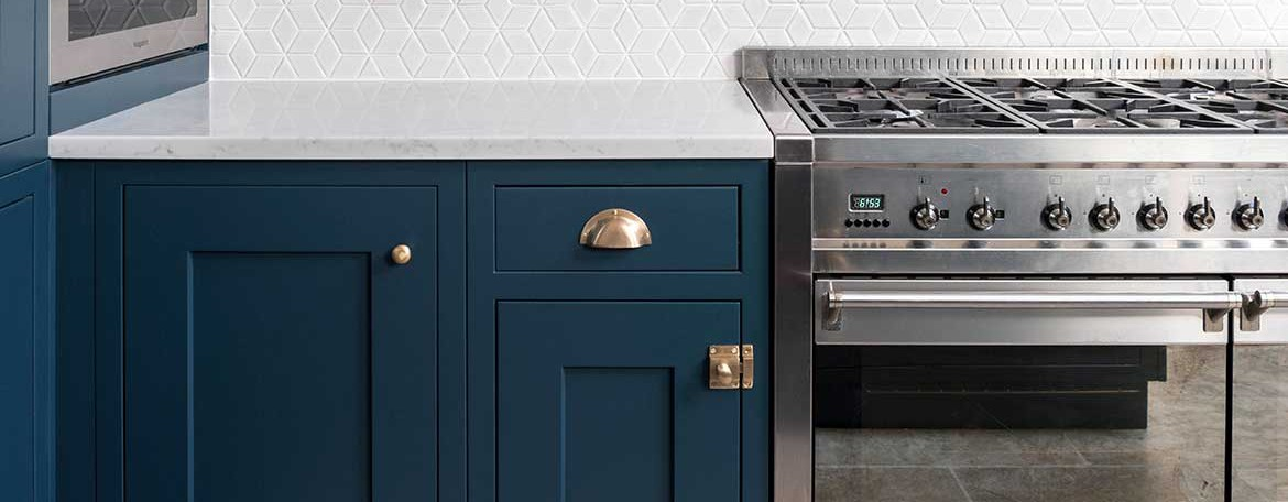 Bespoke kitchen cabinets in a bold blue colour
