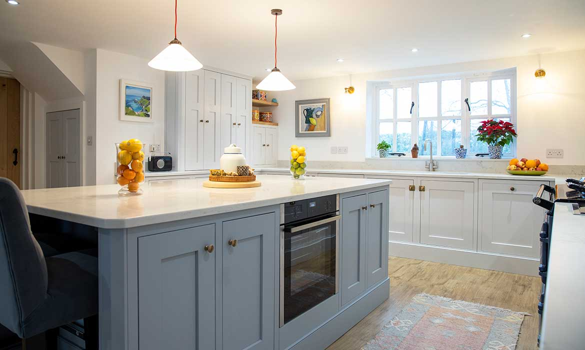 Large shaker kitchen with centre island by Chiddingfold Kitchens